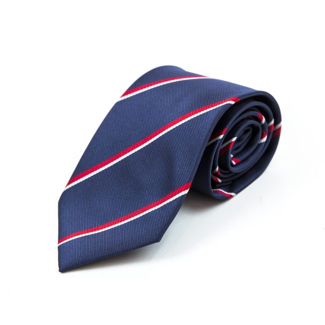 Navy blue and red striped tie rolled up