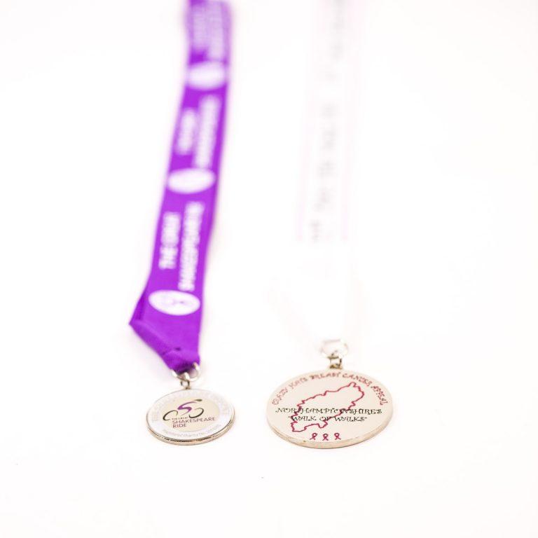 two custom award medals,