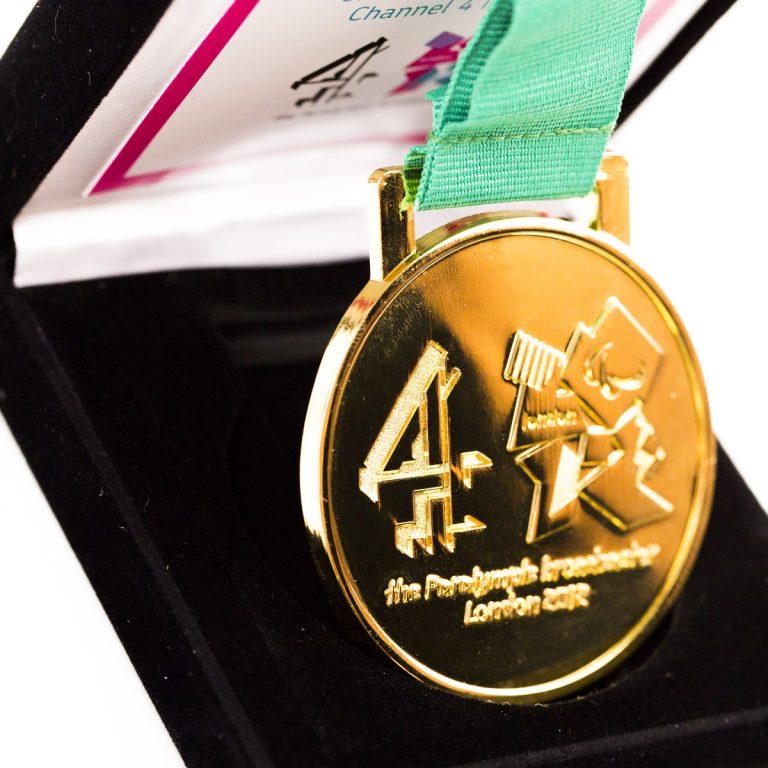 Gold custom medal in black box