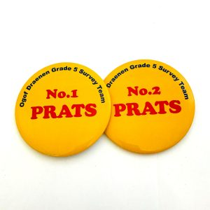 Two yellow button badges