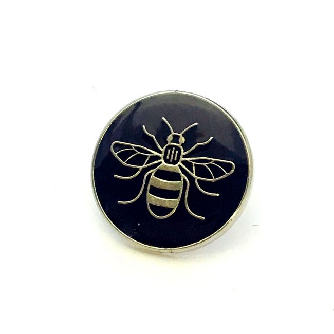 Black badge with Manchester bee