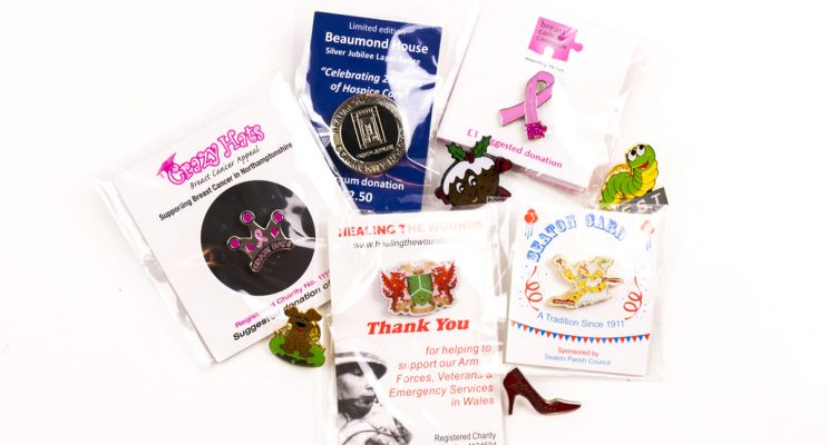 promotional charity pin on backing cards