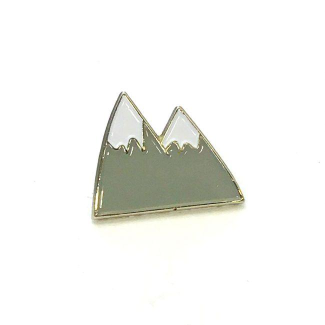 Grey mountain metal pin badge