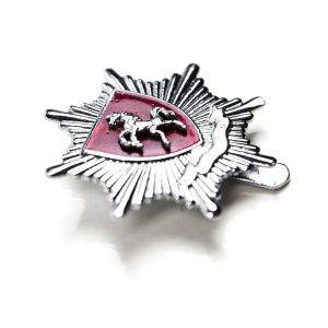 Silver badge with horse logo