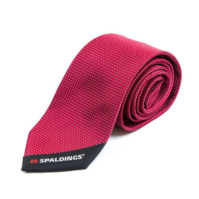 Red tie rolled up with white dots