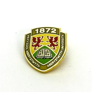 Aberystwyth University school metal badge with logo