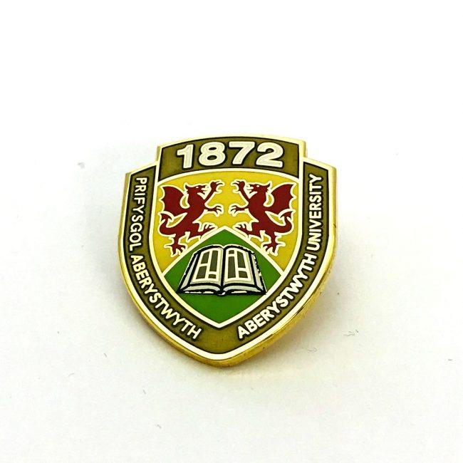 Aberystwyth University school metal badge with logo