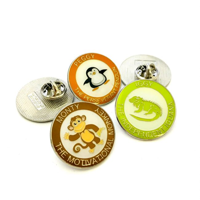 Variety of school badges with cartoon animals on