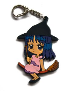 Cartoon witch on broomstick soft keychain