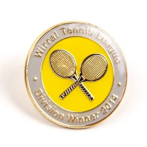 Tennis rackets on metal spots badge