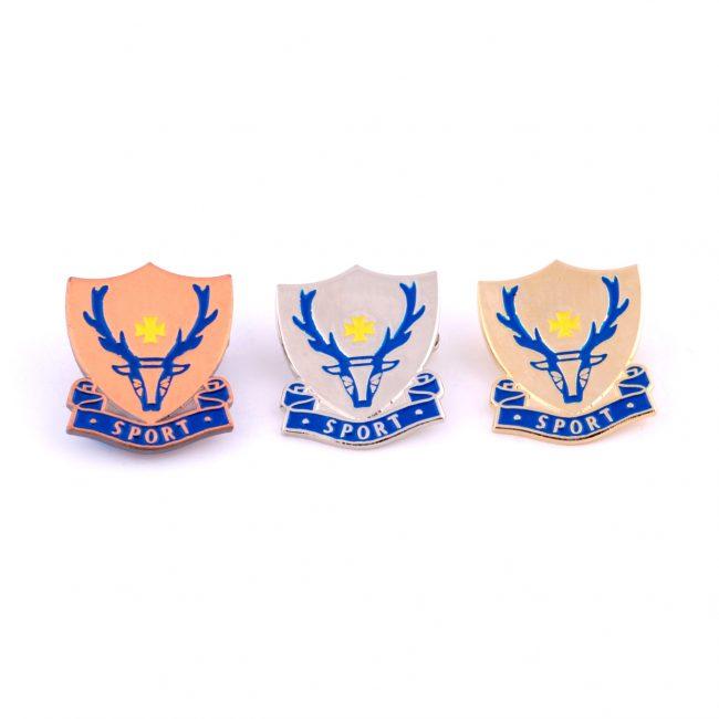 Three sport badges with reindeer logo on