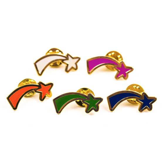 Five shooting star badges all different colours