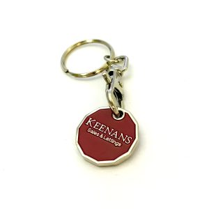 Red trolley coin with Keenans logo and metal chain