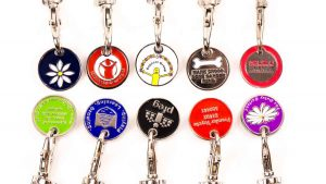 10 Trolley Coins with charity logos