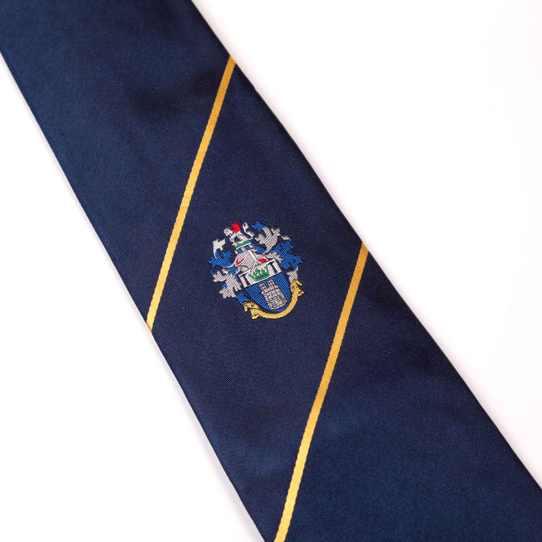 Dark navy blue tie with two gold stripes and embroidered logo