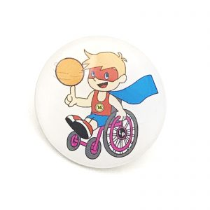 Printed badge with image of boy in superhero costume on wheelchair