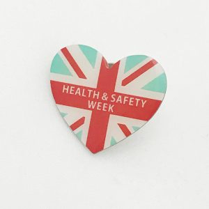 Heart shaped badge with Health and Safety Week