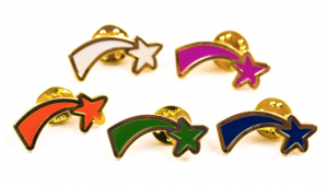five shooting star badges different colours