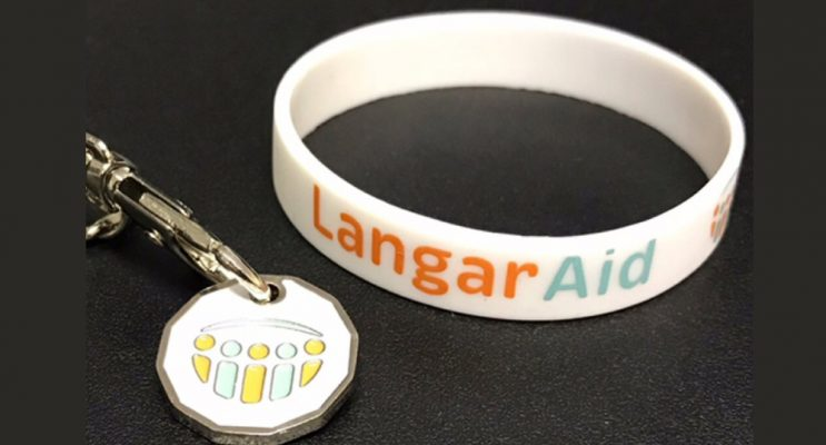 Langar Aid charity wristband and trolley coin with logo