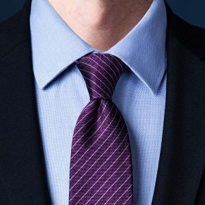 Simple purple knot tie with blue shirt