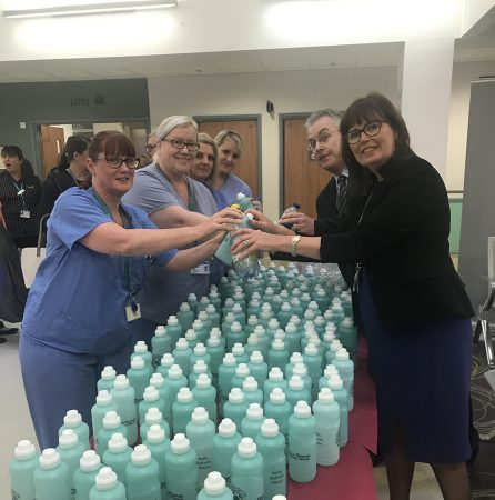 Tameside Hospital staff handing over eco-friendly water bottles