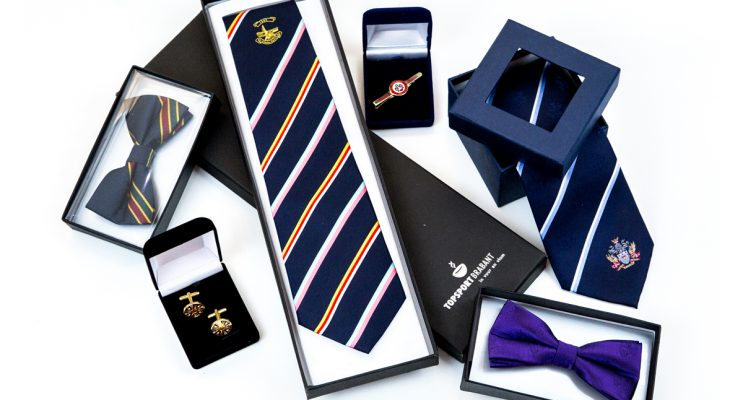 Group of corporate merchandise including matching ties, cufflinks and gift box